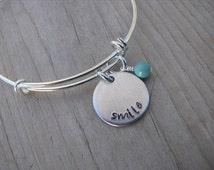 """Inspiration Bracelet- Hand-Stamped """"smile"""" Bracelet with an accent bead in your choice of colors"""