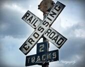 railroad art, train crossing art photo, old railroad crossing sign, rusted metal, industrial art, cloudy sky