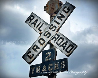 railroad art, train crossing art photo, old railroad crossing sign, rusted metal, industrial art, cloudy sky