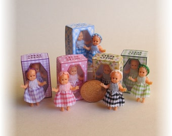Molly Dolly, dolls house miniature toy doll in a box. A dolly for your dolls house doll.