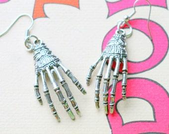 SKELETON HAND Earrings...silver. antique silver charm. skeleton earrings. hand. retro. kitsch. boho. metal. urban. hipster. hippie. creepy