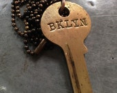 """BKLYN"""" is hand stamped into a lovely brass key with an antique letter set.  hung on a 27"""" darkened brass #3 bead chain"""
