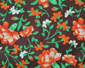 Vintage 1970s printed fabric in highquality unused cotton/ synthetic with larger orange/ green carnation flower pattern on dark brown bottom