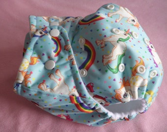 SassyCloth one size pocket diaper with rainbow unicorns PUL print. Made to order.