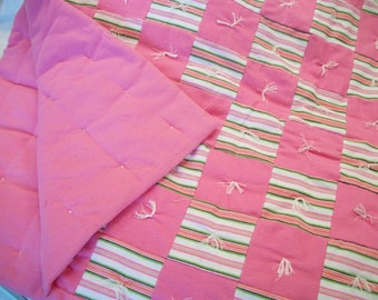 Bright pink baby quilt, with stripes