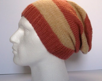 Unisex hand knitted super slouchy beanie hat. Adult or teenager. Terracotta and beige / fawn stripes.