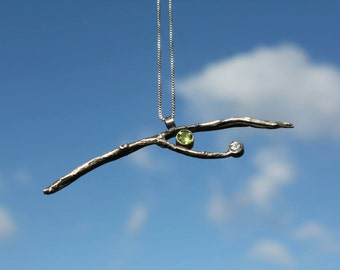 Silver branch necklace with peridot and zircon