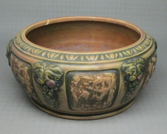 vintage antique roseville florentine bowl with grapes being