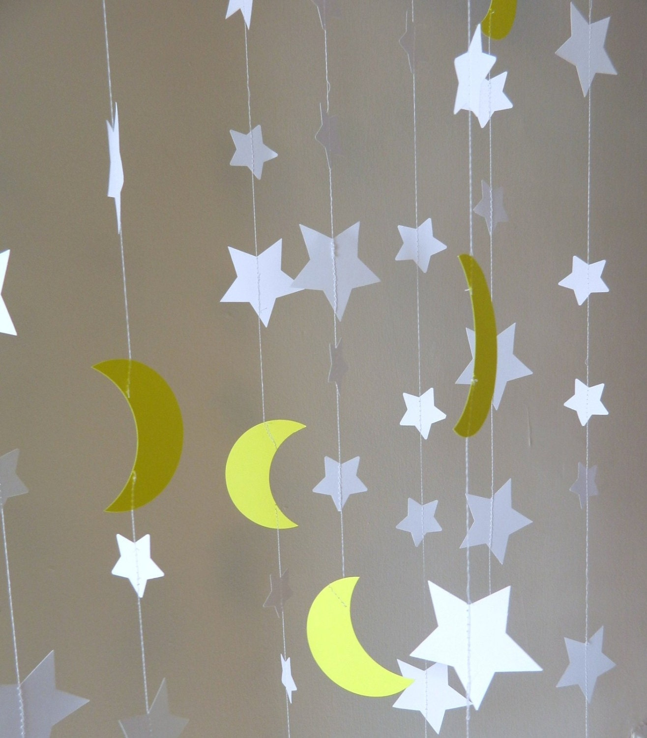 stars and moons paper garlands to the moon and back. Black Bedroom Furniture Sets. Home Design Ideas
