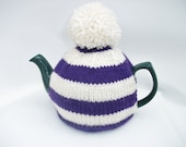 Striped tea cosy purple and cream  with a pompom for a medium pot.