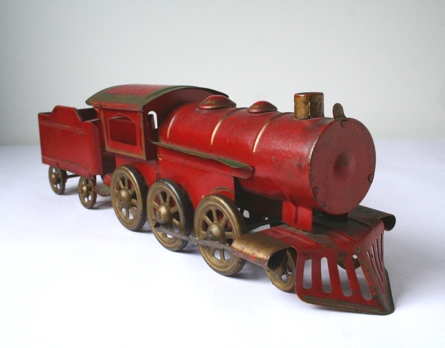 Old Toy Trains : Antique red tin steam engine train and coal tender hill