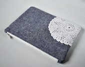 Woman's beauty bag protective vintage doily denim tone linen make up bag padded cosmetics pouch in navy and cream.