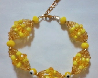 Santeria Yoruba. IDDE bracelet for Oshun Orisha  Pulsera Idde de Mazos para Ochun . osha