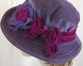 Plum colored velvet hat with magenta band has a memory brim so you can wear it the most flattering way.