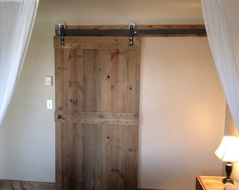 Sliding Barn Door -Interior- Beautiful, slightly rustic pine door stained and finished.