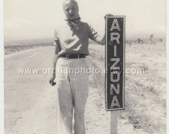 Vintage/Antique photo of a beautiful woman standing next to an Arizona sign