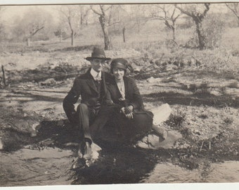 Vintage/Antique photo of a beautiful couple near a stream