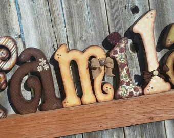 Beautiful family wooden letters, decorated with many beautiful embellishments
