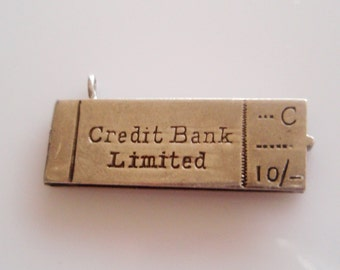 Silver Cheque Book and Cheque Charm Opens
