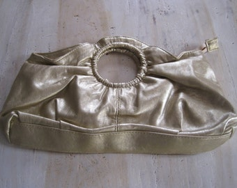 Gold clutch with circle handle