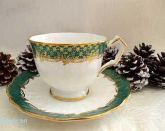 Aynsley Green And Gold Embossed Teacup and Saucer set, c. 1960-1972