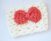 Crochet coffee cozy in cream with cute coral bow