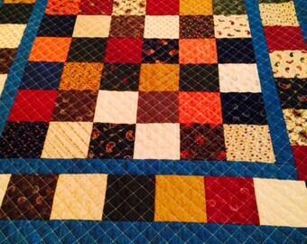 Sale Quilt Lap size Blue Jean material and Charm Squares
