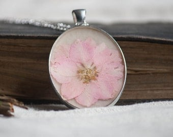 real pressed flower necklace pale pink larkspur dried flower pendant in resin. wedding. bride.