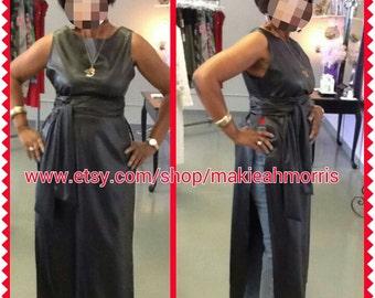 Black long  faux vegan leather t-shirt dress with side slits.