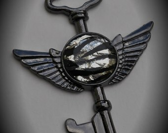 Large Gunmetal Key Pendant With Faceted Cabochon
