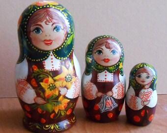 Nesting dolls (matryoshka) in Russian style Volhkvoskaya with sunflowers handmade.