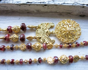 Vintage 8K Gold Tamborin Necklace with Small Round Pendant and Red Faceted Stones from the Philippines