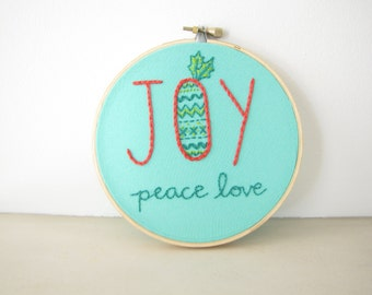 Joy Christmas Embroidery Hoop Wall Art - Holiday Home Decor - peace love fair isle pattern green holly leaves turquoise blue coral
