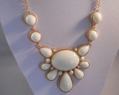 Bib Necklace with Gold Tone and Off White Teardrop Pendant on a Gold Tone Chain
