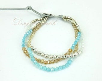 Blue and brow crystal on cotton bracelet.