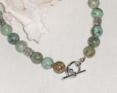 Speckled African green jade round beaded anklet; toggle clasp closure; jade jewelry