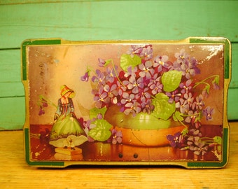 1930 great lithography Antique violets and little lady antique toffee candy tin Made in England Home Decor storage.purple green gold footed