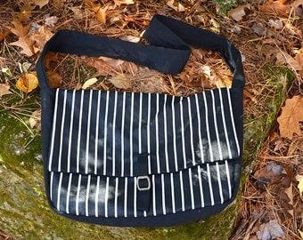 Black and white striped messenger bag