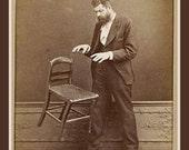 Fridge Magnet vintage image of Magic Man magician levitating a chair sepia tone