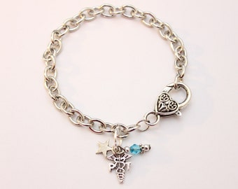 Physical Therapist PT Silver Charm Bracelet With Coordinating Glass Bead