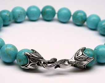 Genuine  10 mm turquoise bead bracelet with a hand made sterling silver hook and lock system