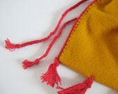 lined yellow medieval textile bag with tassels