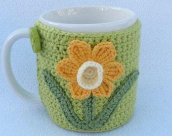 Crochet Mug cozy with applique daffodil.
