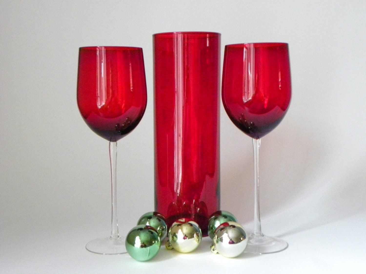 Red glass entertaining centerpiece two wine glasses and a