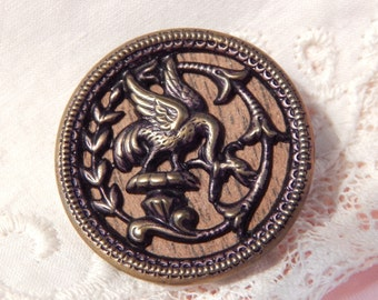 Fabulous Winged Creature on an Antique Woodback Button