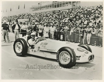 Jerry Unser Jr. racing champion driver in race car vintage photo