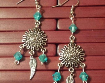 Silver and blue dangles with feather