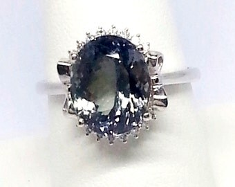 6.63ct Tanzanite and .16ctw Diamonds 14kt White Gold Ring Size 9.25