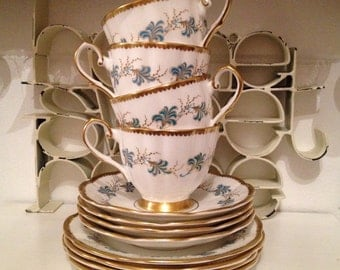 1960s Vintage Taylor Kent Elizabethan teacup Trio with heavy gilding and teal blue pattern on fluted tea cups. TT078.
