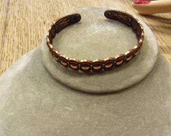 Native Snake Eyes design brass very petite bracelet